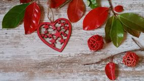 Red heart and autumn leaves on wooden background. Red heart and colorful autumn leaves on old white background Stock Photography