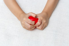 Red heart in baby palm hands Royalty Free Stock Images