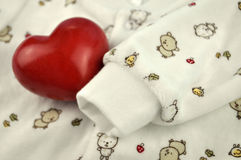 Red Heart On Baby Sweater Royalty Free Stock Photos