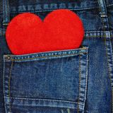 Red heart in a back pocket of a jeans Stock Image