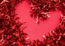 Red heart on a red background new year Saint Valentine stock images