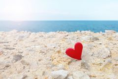 Red heart on the background of sea. royalty free stock photo