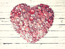 Red heart background on vintage old surface. Stock Image