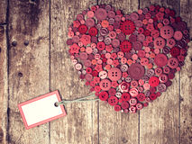 Red heart background on vintage old surface. Stock Photos