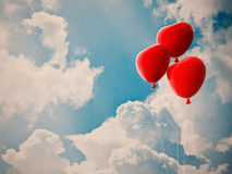 Red heart balloon and cloudy sky Stock Images