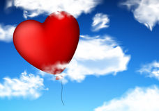 Red heart balloon in sky. Stock Image