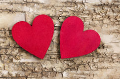 Red heart on bark background. Symbol of love Royalty Free Stock Image