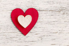 Red heart on bark background. Symbol of love Stock Image