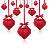 Red Heart Baubles. Red heart shaped christmas baubles with ribbon and bows, isolated over white background Stock Photos