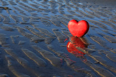Red heart on the beach. Royalty Free Stock Images