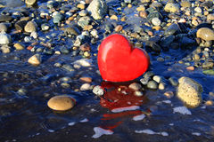 Red heart on the beach. Stock Photo