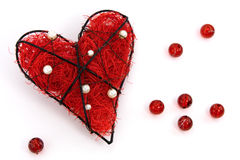 Red heart with beads Royalty Free Stock Photos