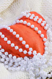 Red heart and beads from pearls Stock Photos