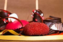 Beautiful red beaded heart. Delicious cakes. Valentine`s Day stock photography