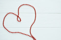 The red heart of beads Stock Photography