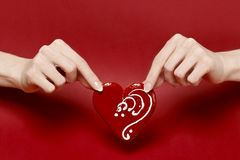 Red heart in beautiful hands Royalty Free Stock Images