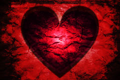 Red heart black. Dark passion: glowing red heart black. Rough vibrant red texture with burnt edges Stock Photography