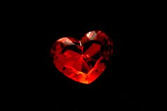 Red heart on the black background Royalty Free Stock Images