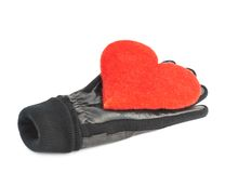 Red heart in black leather gloves. Composition of the red heart in black leather glove, isolated over the white background Royalty Free Stock Photography