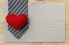 Red heart on black necktie Stock Images