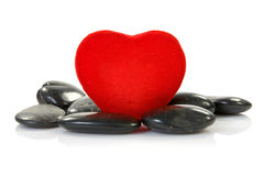 Red heart with black stones Stock Photos