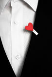 Red heart on a black suit Royalty Free Stock Image
