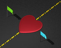 Red heart on black surface with boundary line and flags Stock Photos