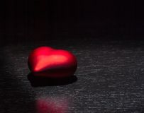 Red heart  on black wood table, concept of valentine day Stock Image