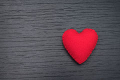 Red heart on black wooden background royalty free stock photos