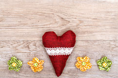 Red heart and blossoms of cloth Royalty Free Stock Images