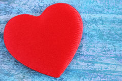 Red heart on a blue abstract background Royalty Free Stock Images