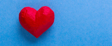 Red heart on a blue background Royalty Free Stock Photo