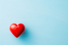 Red heart on blue background. Stock Image