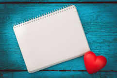 Red heart on the blue boards Stock Photo
