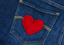Red heart on blue denim jean pocket Stock Photography