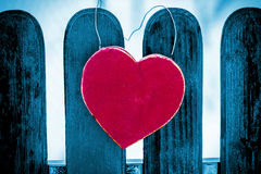 Red heart on blue fence Royalty Free Stock Image