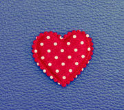 Red heart on blue leather vintage background Royalty Free Stock Photo