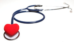 Red heart and a blue stethoscope isolated Royalty Free Stock Image