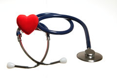 Red heart and a blue stethoscope isolated Royalty Free Stock Photography