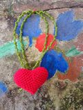 Red heart on blue and red wall Royalty Free Stock Photography
