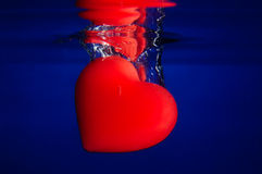 Red heart into blue water Royalty Free Stock Photo