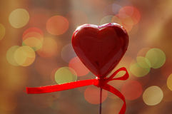 Red heart on bokeh background Stock Photos