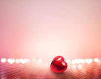 Red heart and bokeh on wooden floor vibrant for background Stock Photography