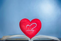 Red heart on book. Heart of the book. Greeting cards Stock Images