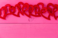 Red heart border for romance and love. Over a shocking pink background with copy space for your Valentines, wedding or anniversary greeting Stock Photo