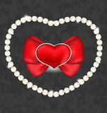 Red heart with bow and pearls for Valentine Day Stock Photography