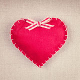 Red heart with a bow on vintage fabric Stock Photography