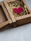 Red heart in a box in the form of an open book royalty free stock image