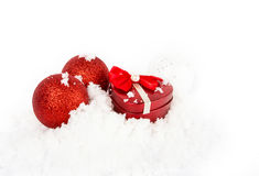 Red heart box in snow. On white Stock Photos