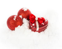 Red heart box in snow. On white Royalty Free Stock Photo